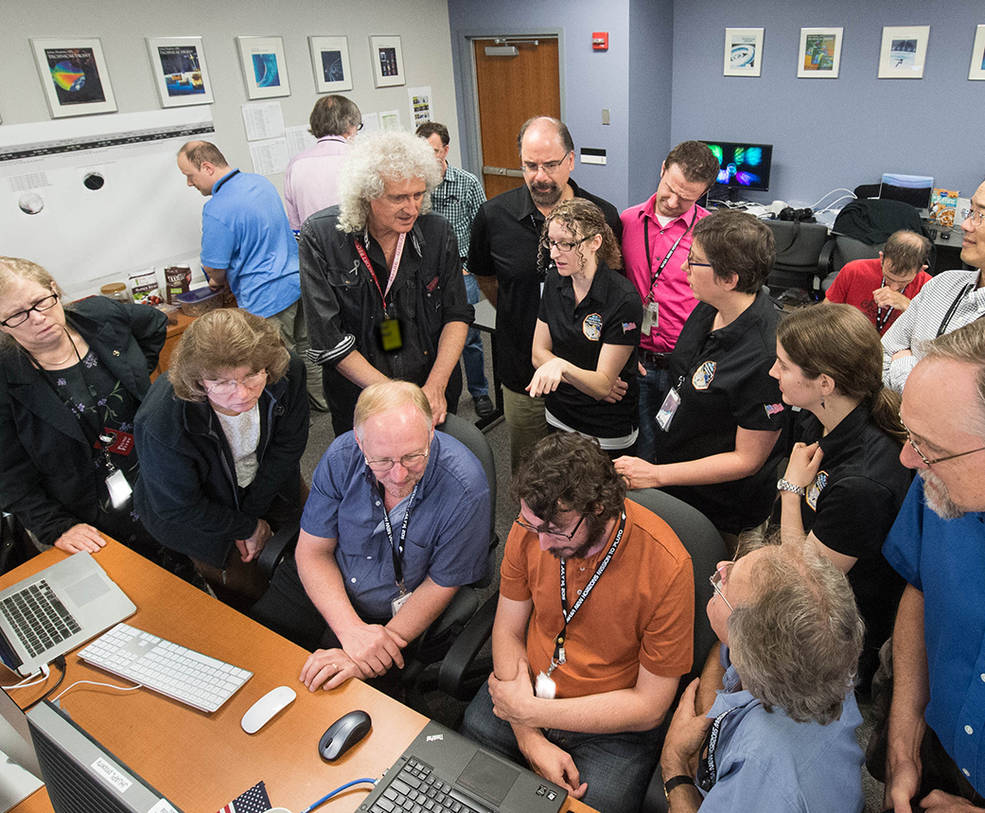 Dr. Brian May discusses the latest images of Pluto and Charon with members of the New Horizons GGI team, Johns Hopkins University Applied Physics Laboratory, Laurel, Maryland. Image Credit: NASA/JHUAPL/SwRI/Henry Throop