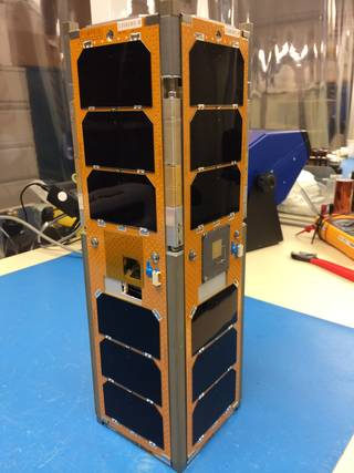 The Low Mass Radio Science Transponder-Satellite (LMRST-Sat) is about 4 by 4 by 12 inches (10 by 10 by 30 centimeters) in size and weighs as much as a kid's bowling ball (8 pounds or, 4 kilograms). The CubeSat is a collaboration between NASA's Jet Propulsion Laboratory in Pasadena, California, and Stanford University's Space and Systems Development Laboratory, Stanford, California. Image Credit: NASA/JPL-Caltech