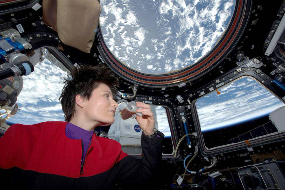 talian astronaut Samantha Cristoforetti enjoys espresso from a zero-G cup while gazing out the cupola on the International Space Station. Image Credit: NASA