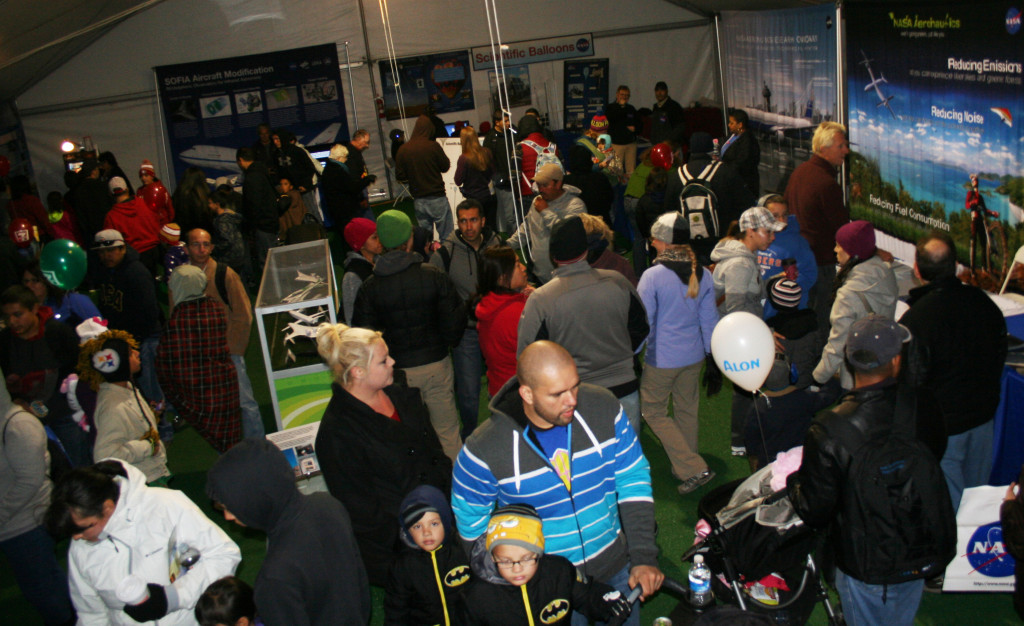 The NASA exhibit attracts a number of visitors. Image Credit: NASA / Jay Levine