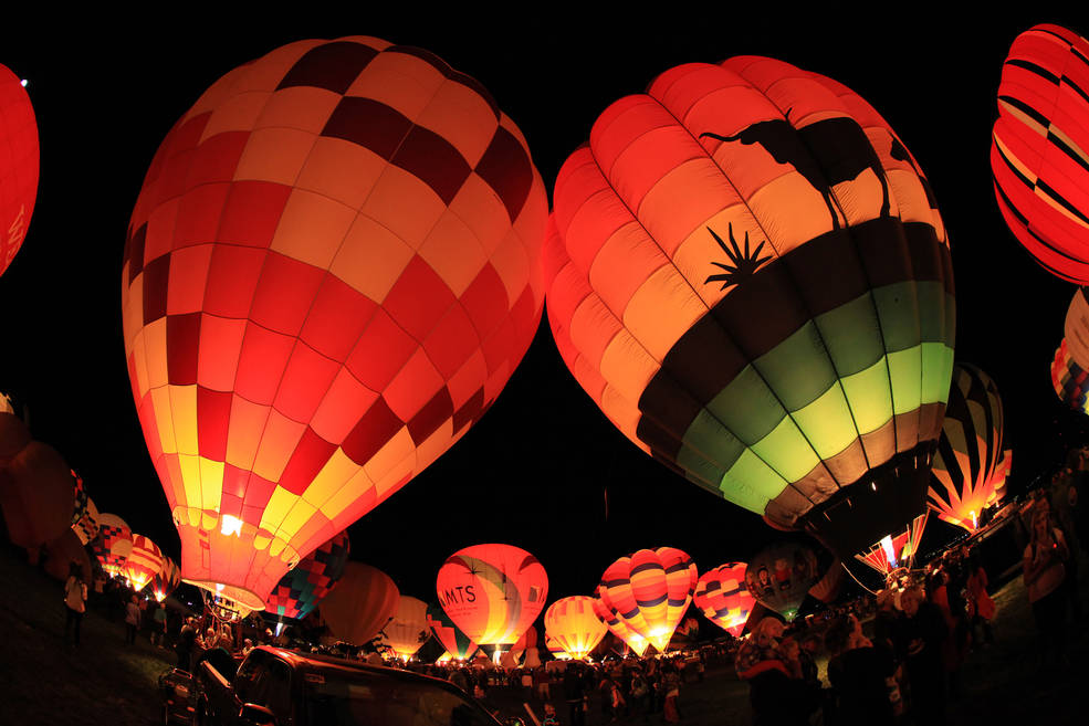 Evening Night Glow events include a coordinated effort for all the balloons light up at once. Image Credit: NASA / Patrick Rogers