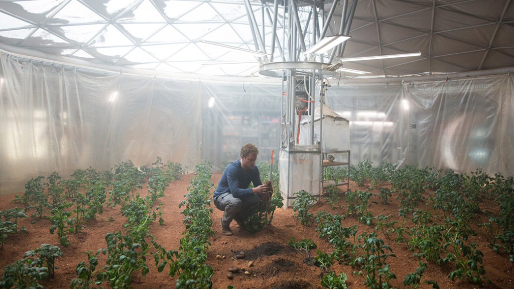 """n a scene from """"The Martian,"""" astronaut Mark Watney employs some ingenious methods to plant crops on Mars. Image Credit: Peter Mountain"""