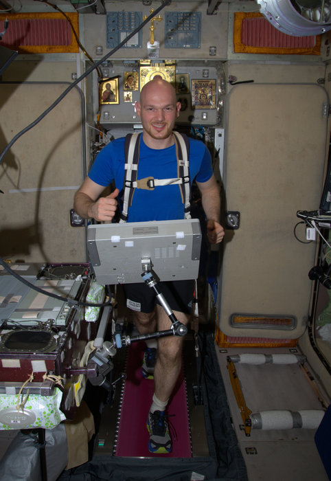 ESA astronaut Alexander Gerst running on the International Space Station as part of every astronaut's 90-minute exercise routine. In microgravity astronaut's bones and muscles waste away. An effective way of counteracting this is by keeping fit, however floating in weightlessness makes running difficult. Elastic bands keep Alexander in place and push his body down on the treadmill. Image Credit: ESA/NASA