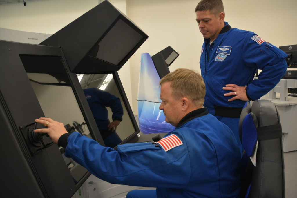 NASA astronauts Eric Boe (left) and Bob Behnken inspect the controls of Boeing's CST-100 Starliner Crew Part Task Trainer as part of an early look at one of the systems that will prepare them for flight tests and missions. Image Credit: Boeing