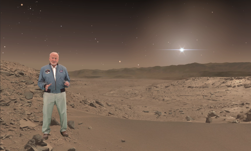 "Buzz Aldrin, an Apollo 11 astronaut who walked on the moon, makes a holographic appearance in ""Destination: Mars,"" a mixed-reality tour of a part of Mars that NASA's Curiosity rover has explored. Image Credit: NASA/JPL-Caltech/Microsoft"