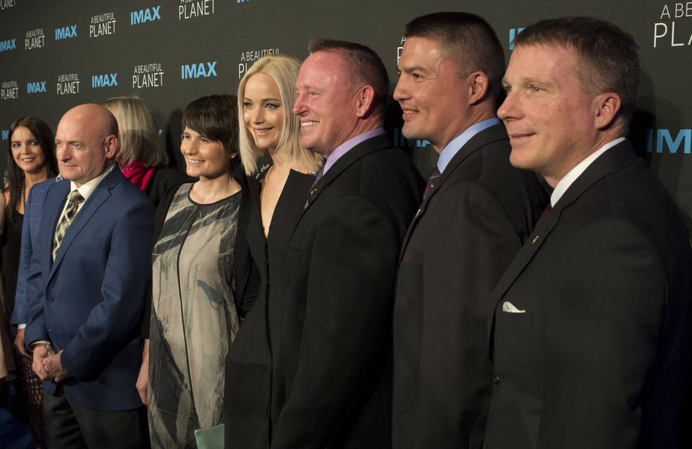 "Former NASA astronaut Scott Kelly, left, ESA astronaut Samantha Cristoforetti, second from left, Jennifer Lawrence, third from left, NASA astronaut Barry Wilmore, third from right, NASA astronaut Kjell Lindgren, second from right, and NASA astronaut Terry Virts, right, post for a picture as they arrive for the world Premiere of the IMAX film ""A Beautiful Planet"" at AMC Lowes Lincoln Square theater on Saturday, April 16, 2016 in New York City.  The film features footage of Earth captured by astronauts aboard the International Space Station.  Image Credit: NASA/Joel Kowsky"