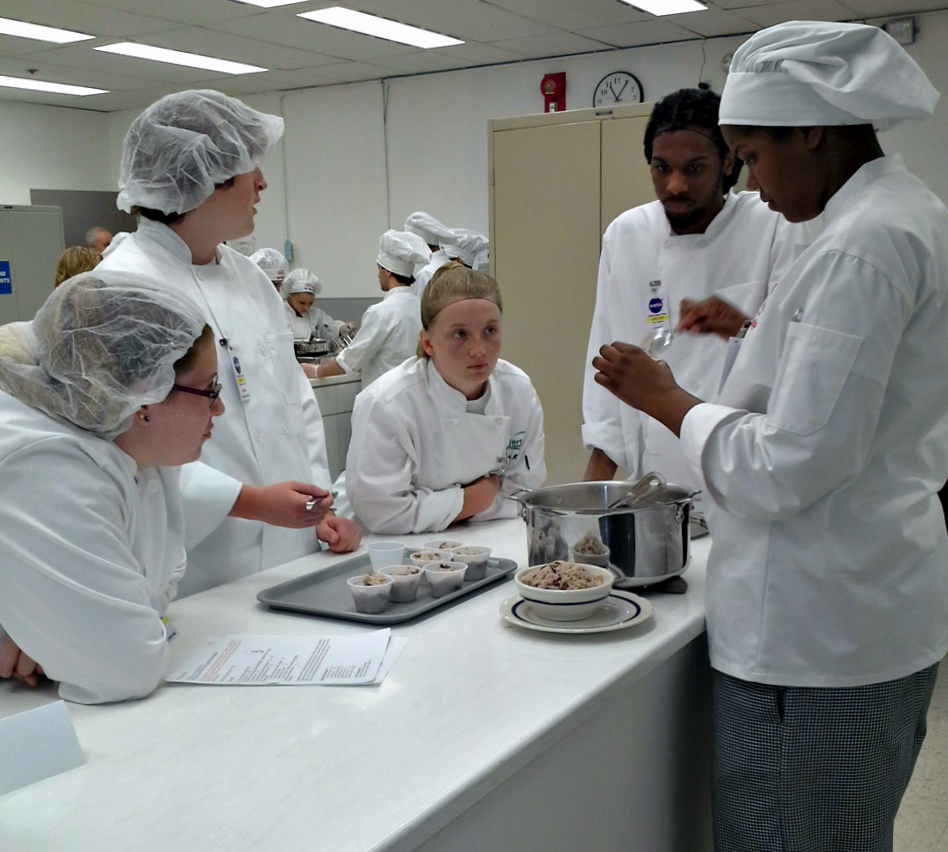 Students from the 2015 Phoebus team, left to right, Sarah Hayes, Rhett Hughes, Taylor Holden, Raequan Ricks and Brittney Richards consider their culinary creation. Image Credit: NASA