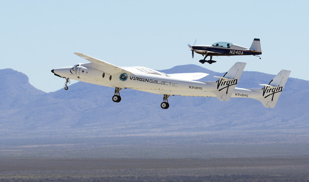 Virgin Galactic's WhiteKnightTwo piloted by Kelly Latimer and Dave Mackay and an Extra 300 chase plane fly operational tests at Spaceport America on Wednesday, April 20 , 2016. Image Credit: Greg Sorber/Albuquerque Journal