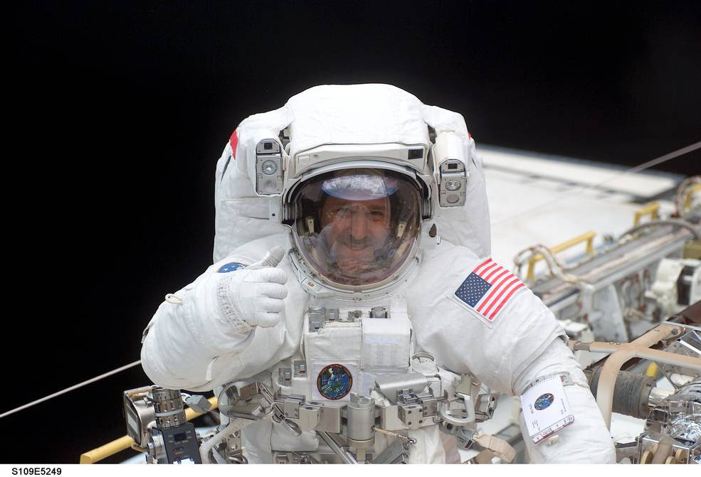 In this March 2002 image, John Grunsfeld, former astronaut and associate administrator of NASA's Science Mission Directorate, In this image from March 2002, is shown in space shuttle Columbia's cargo bay. Image Credit: NASA
