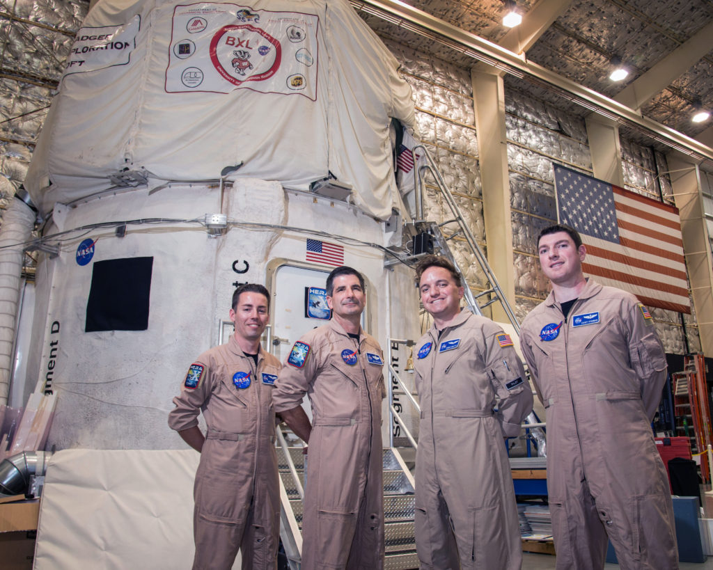"Astronauts of the HERA 10 crew began their mission on May 2nd. The ""splashdown"" on June 1, ending their 30 day analog mission aboard the HERA simulated spacecraft. Image Credit: NASA/Bill Stafford"