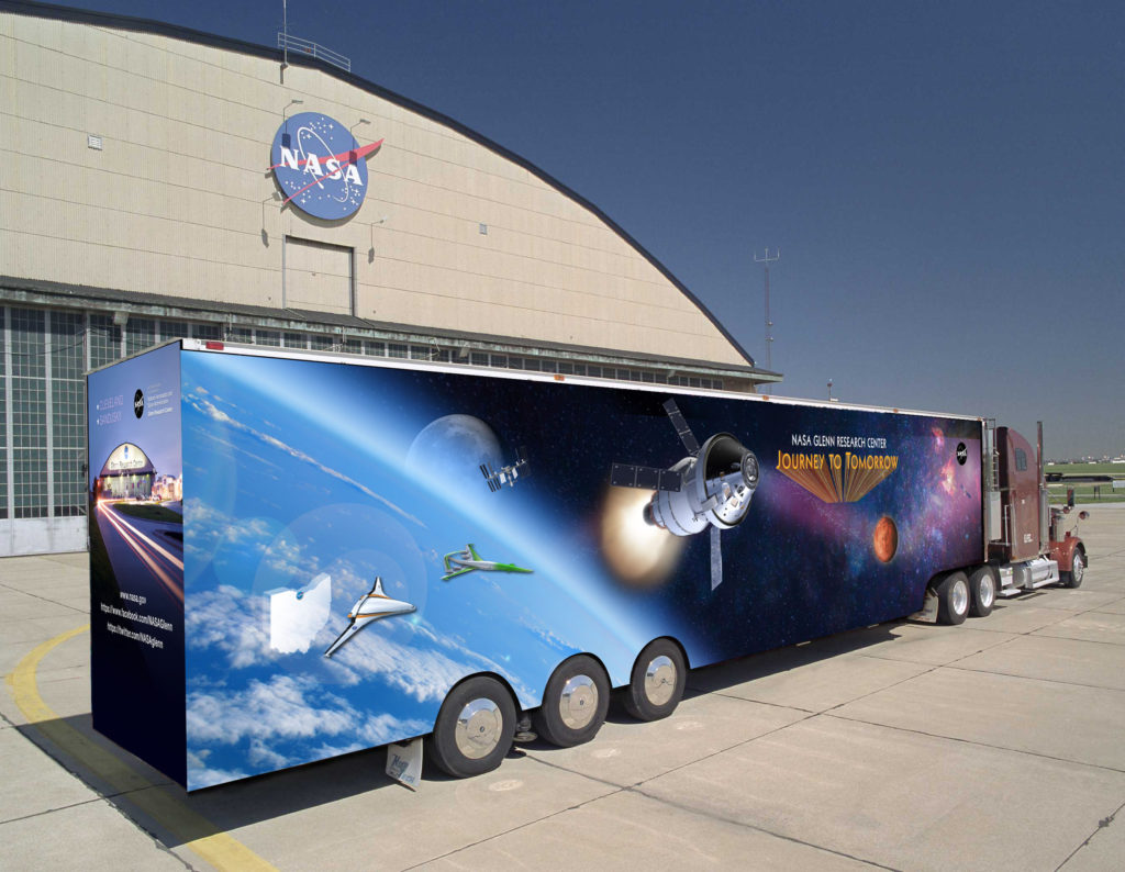 Journey to Tomorrow is one of NASA's premier traveling exhibits. Based at the NASA Glenn Research Center in Cleveland, Ohio, the 53-foot exhibit trailer brings the excitement of exploration in air and space to community and school events while providing a unique and interactive learning environment. Image Credit: NASA