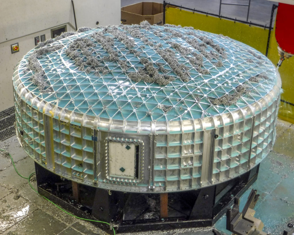One of the lower domes for Boeing's CST-100 Starliner spacecraft is machined to create 1,500 pockets in the formed blank of space-grade aluminum alloy. The pockets required hundreds of machining hours and leave the domes with a honeycomb pattern that reduces weight but preserves the structure's strength. Image Credit: Janicki Industries