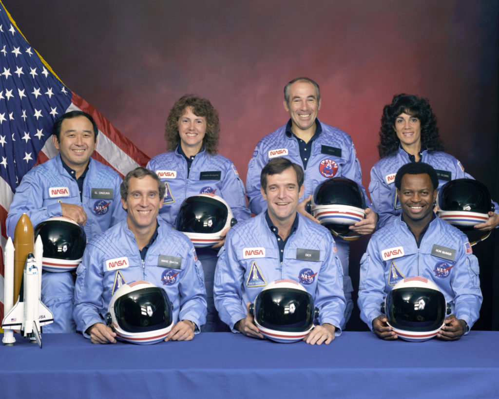 The STS-51L crew was lost 73 second after launch on Jan. 28, 1986. Crewmembers included, front row from left, Michael J. Smith, Francis R. Scobee and Ronald E. McNair. In the back from left are Ellison S. Onizuka, Sharon Christa McAuliffe, Gregory B. Jarvis and Judith A. Resnik. Image Credit: NASA