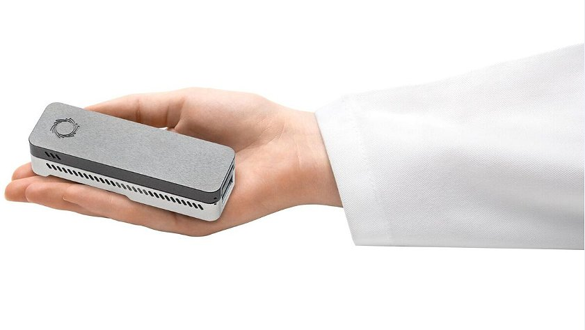 The MinION™ DNA sequencer from Oxford Nanopore Technologies fits in the palm of a hand. Image Credit: Oxford Nanopore Technologies