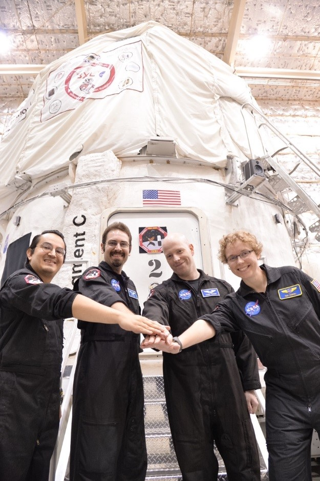 Crew members Emmanuel Urquieta, Kyle Foster, Daniel Surber, and Tess Caswell celebrate a successful HERA Mission 11 on Aug. 10 at NASA Johnson Space Center. Image Credit: NASA