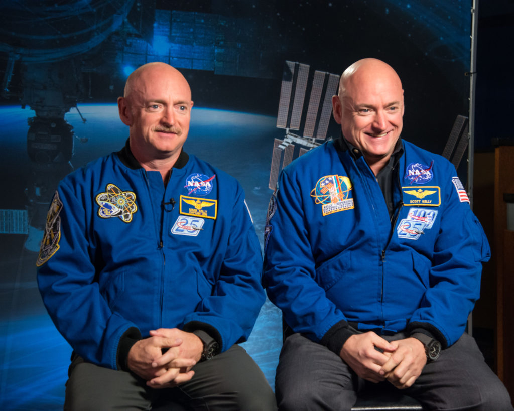 Expedition 45/46 Commander, retired astronaut Scott Kelly (right) along with his twin brother, retired astronaut Mark Kelly (left) speak to media about the Twins Study and One-Year Mission. Image Credit: NASA/Robert Markowitz