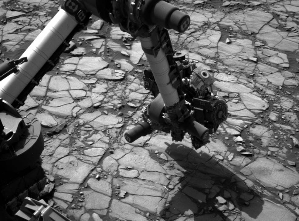 "NASA's Curiosity Mars rover began close-up investigation of a target called ""Marimba,"" on lower Mount Sharp, during the week preceding the fourth anniversary of the mission's Aug. 6, 2016, landing. Curiosity's Navigation Camera took this shot of the rover's arm over Marimba on Aug. 2, 2016. Image Credit: NASA/JPL-Caltech/MSSS"
