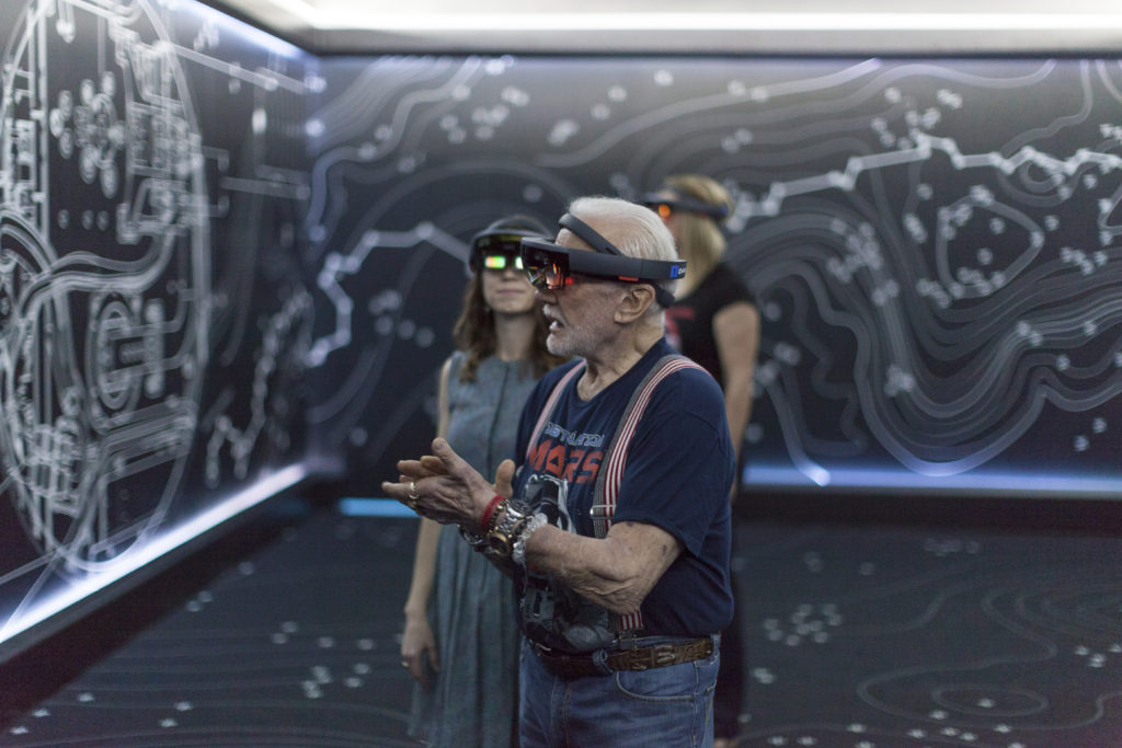 """Apollo 11 astronaut Buzz Aldrin, right, and Erisa Hines of NASA's Jet Propulsion Laboratory in Pasadena, California, try out the Microsoft Hololens mixed reality headset during a preview of """"Destination: Mars"""" at Kennedy Space Center visitor complex in Florida. Based on OnSight, a tool created by JPL, """"Destination: Mars"""" lets guests experience Mars with holographic versions of Aldrin and Hines as guides. Image Credit: NASA/Charles Babir"""