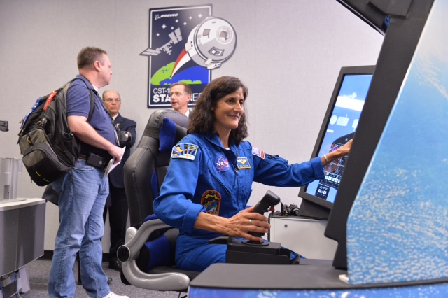 Williams takes the helm at the Crew Part-Task Trainer, which simulates Boeing's CST-100 Starliner Spacecraft. Image Credit: NASA/Lauren Harnett