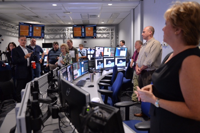 Media gather in The Bridge, the room where training officers will operate simulations of the Boeing Starliner trainer. Image Credit: NASA/Lauren Harnett
