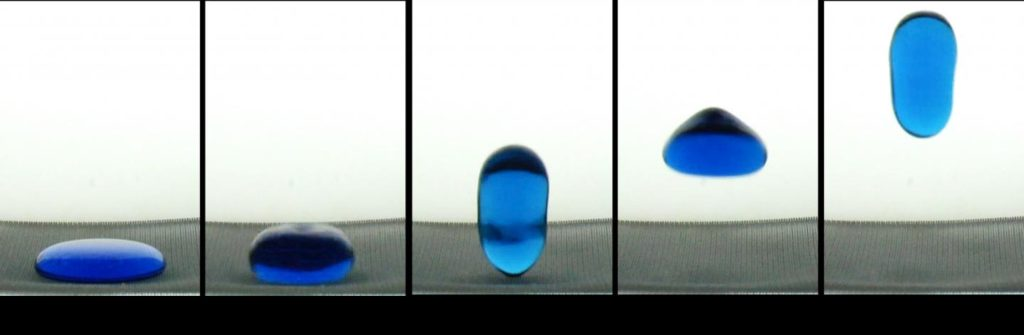 """A 2-mL """"puddle"""" of water spontaneously jumps from a hydrophobic surface upon release into a free fall. Image Credit: Weislogel"""