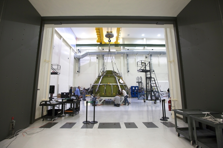 Lockheed Martin engineers and technicians prepare the Orion pressure vessel for a series of tests inside the proof pressure cell in the Neil Armstrong Operations and Checkout Building at NASA's Kennedy Space Center in Florida. Image Credit: Lockheed Martin/Business Wire