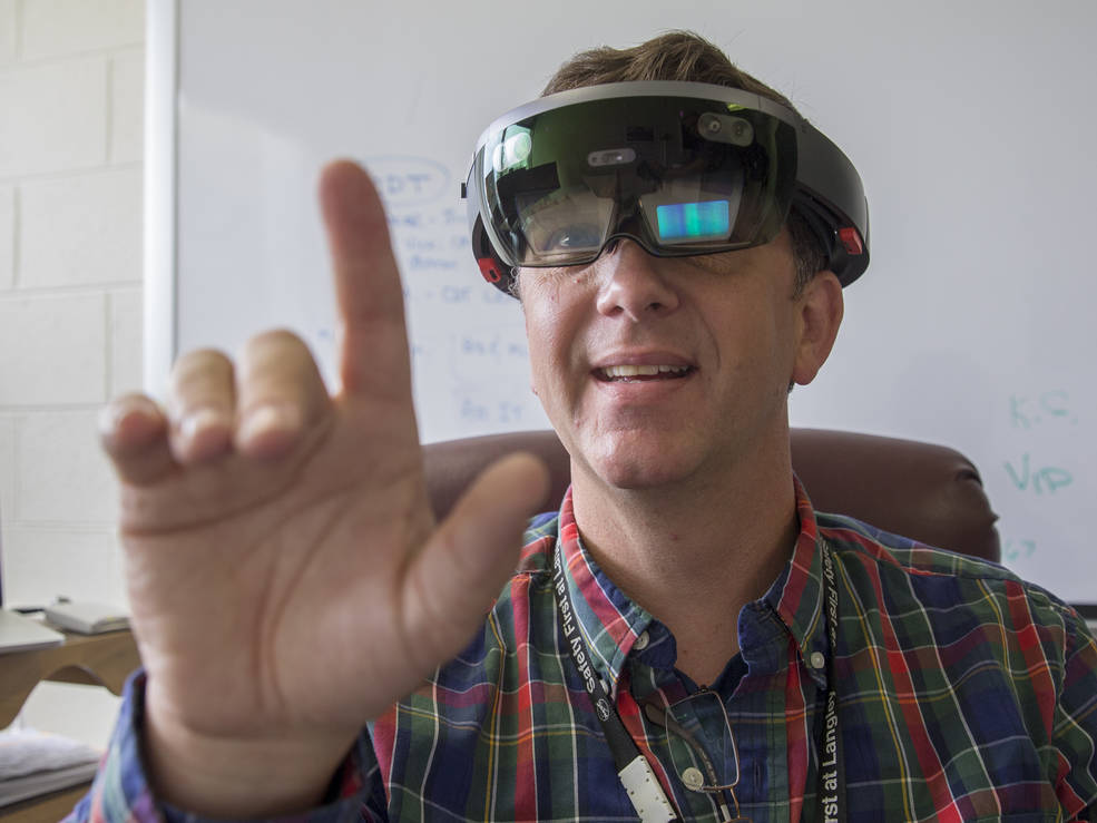 NASA Langley Research Center information technology specialist Ed McLarney demonstrates working in virtual reality with a Microsoft Hololens headset. Image Credit: NASA/David C. Bowman